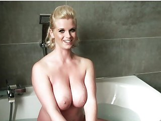 Glamorous blonde Sofia shows her big tits