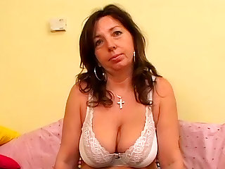 Mature brunette Jarmila S with natural big tits is here to show her kitty