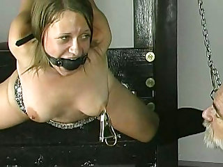 Sexy blonde with gag in mouth being humiliated