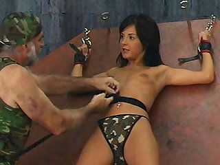 Hot brunette being tied with chains and humiliated