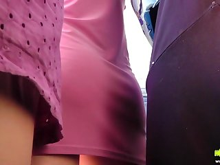 Public upskirt video is filmed in the middle of the bus ride
