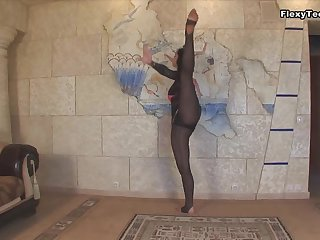 Flexible Russian cutie Maria Gudok strips and does some yoga