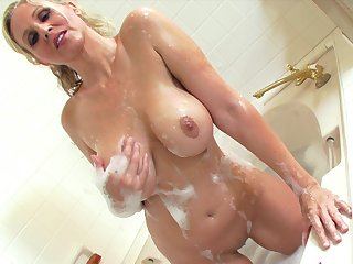 Skillful milf with soapy body Julia Ann is playing with her awesome naked shape in the bathroom so sweet