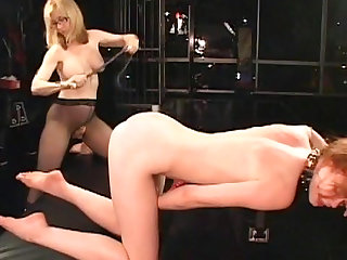 Justine Joli and Nina Hartley with big tits are eating up their pussies in this female domination video.