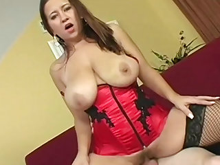 Alanna Ackerman models a stunning red satin corset and takes big cock in the pussy.