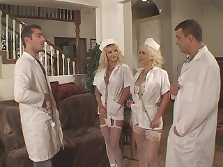 She has huge fake tits and in the vintage porn she gets laid by a doctor with a big cock.