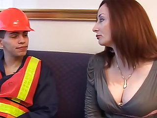 This stunning MILF redhead with big tits is getting her nipples sucked by a man wearing a worker uniform and then getting hardcore sex.