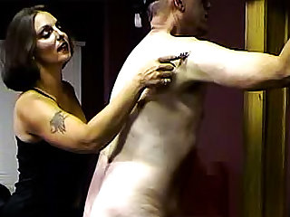 Get a load of this fetish video in which this MILF brunette with a tattoo is spanking her submissive slave.