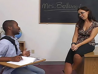 Maria Bellucci is getting naughty in the classroom. Enjoy this teacher with big tits wearing glasses and getting her shaved pussy nailed in this interracial video.