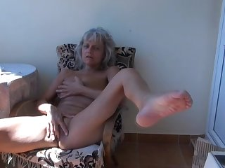 Solo clip with mature blonde that is lying on the chair with pink pussy on the fresh air