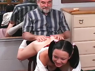 Hot pigtailed schoolgirl getting nice spanking for her cute little pussy from that muscular old fart