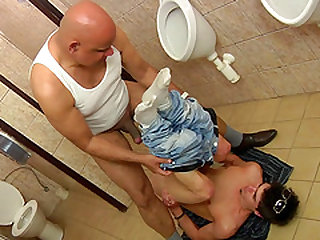 Cute hunk fucked hard by an experienced lover in a toilet