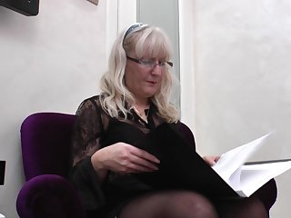 While at work this mature secretary has a smoke and fingers her slit