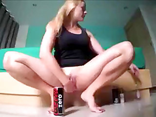 Cola bottle in my shaved wet pussy