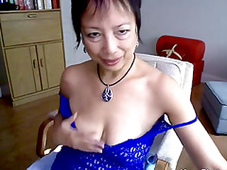 A horny Asian mature gives a kinky webcam show, showing us her saggy tits and meaty cunt