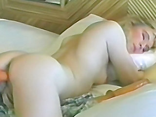 Hot blonde with small tits stuffs her trimmed pussy with a big vibrator