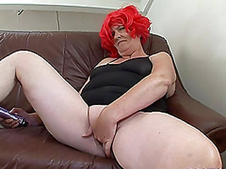Louise is a woman with a wig who wants to feel some semen