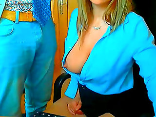 Blonde secretary girl teases her boss with her big tits