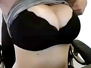 Woman flashes big boobs on cam
