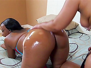 black booty lesbian strapon fuck with oily booty and a huge strapon dildo