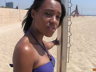 Tanning ebony girl with a fine ass is invited home to fuck