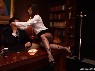Dominant secretary lets him lick her feet for his pleasure