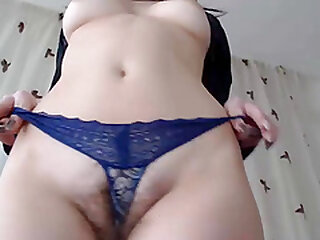 Sexy blonde girl rubs her hairy pussy in front of a webcam