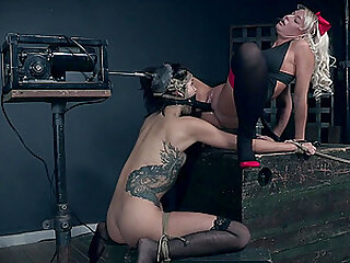 Eden Sin strapped to a table and tortured by machines and London River