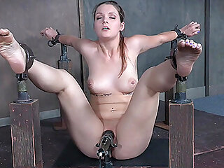 Teen slave girl Nora Riley has an orgasm with her legs and arms tied
