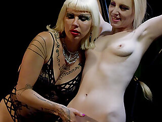 Strict blonde lesbian mistress abuses her tied up slave with toys