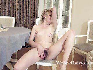 Barbara strips naked and masturbates on her carpet