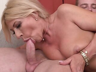 Mature blonde is a wonderful cocksucker for him