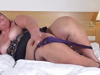 Super fat older babe fucks a toy into her cunt