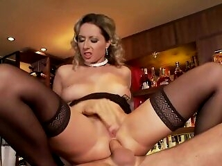 Blonde babe Daria fucked on a bar wearing thigh high stockings and heels