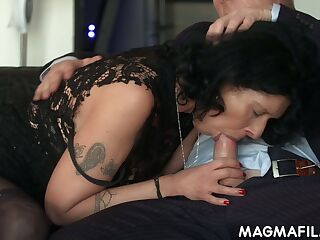Vulgar cougar gets intimate with one of her business partners right in the office
