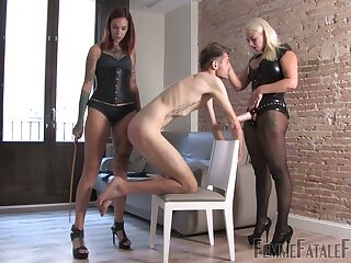 Two mistresses in latex outfits put on strapon and humiliate one submissive dude