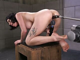 Short haired brunette Olive Glass is testing new sex machine and vibrator