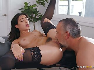 Seductive Asian tries white inches up her trimmed pussy