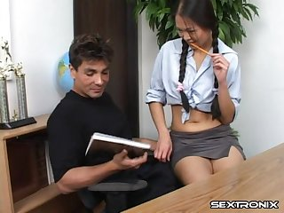 Naomi Zen a tempting milf serving her teacher doggystyle sex in n office