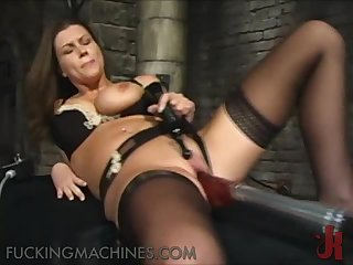 Fucking Machine Penetrating a Brunette's Pink Pussy In Dungeon
