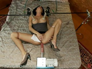 Brunette Shows Her Perfectly Round Tits As She Gets Fucked By A Machine