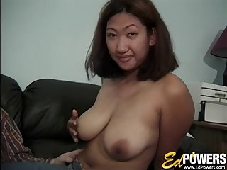 Busty Oriental wench slides a throbbing meat pole in her juicy snatch