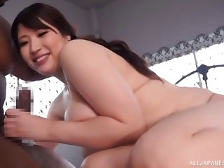 Beautiful curvaceous Japanese chick fucking a big black cock
