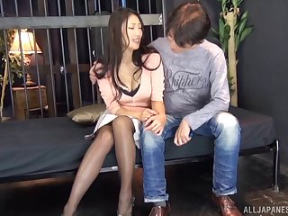 Tearing open the pantyhose of a big tits Asian beauty