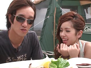 Asian girlfriend gives a blowjob while camping outdoors