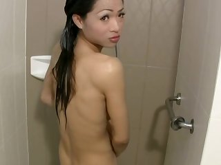 Asian tranny goes from swimming pool directly to cock riding